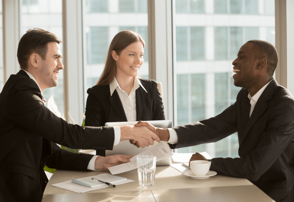 A business meeting handshake