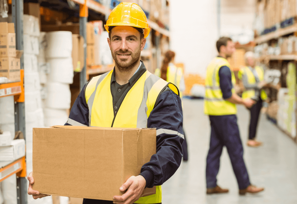 Warehouse worker manual handling with box